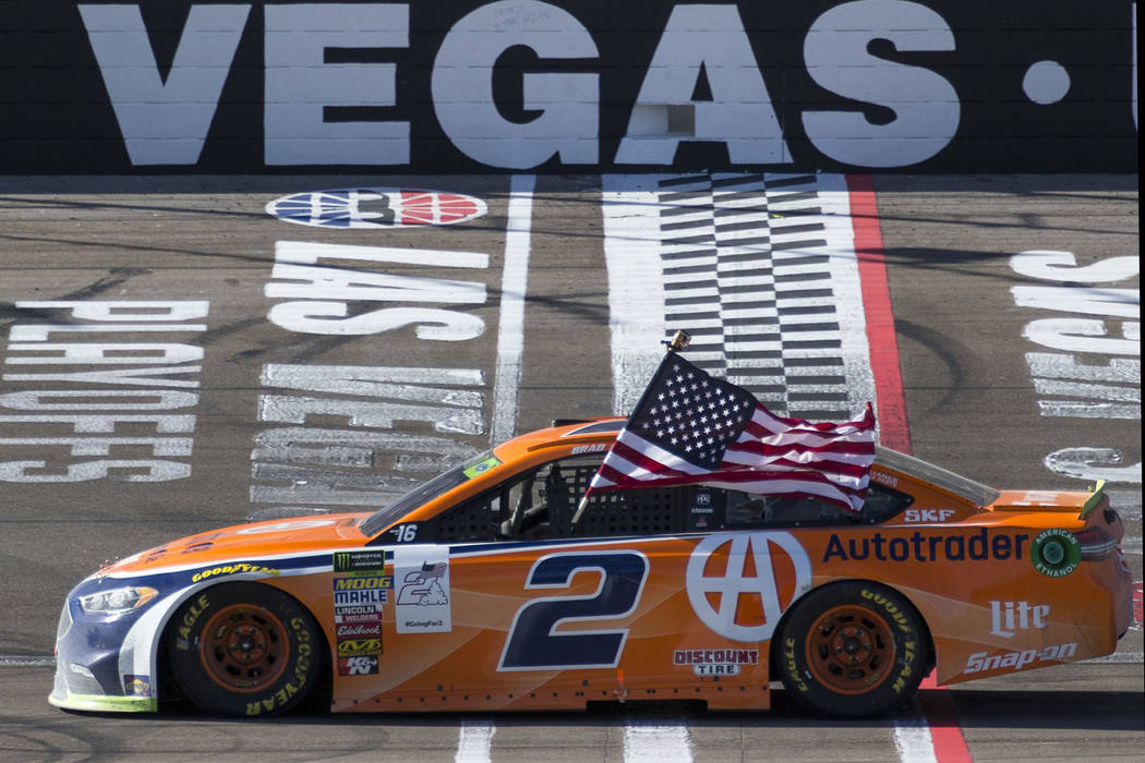 Race car driver Brad Keselowski celebrates at the start/finish line after winning the South Point 400 NASCAR Cup Series auto race at the Las Vegas Motor Speedway in Las Vegas on Sunday, Sept. 16, ...