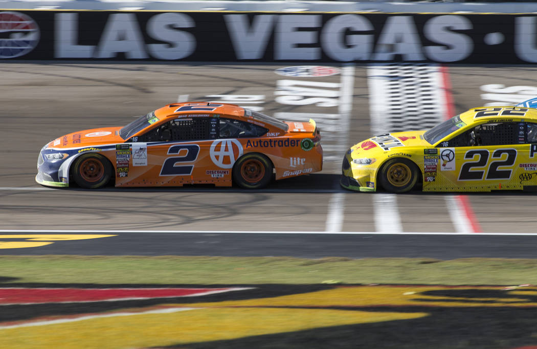 Brad Keselowski (2) races ahead of Joey Logano (22) during the South Point 400 NASCAR Cup Series auto race at the Las Vegas Motor Speedway in Las Vegas on Sunday, Sept. 16, 2018. Richard Brian Las ...