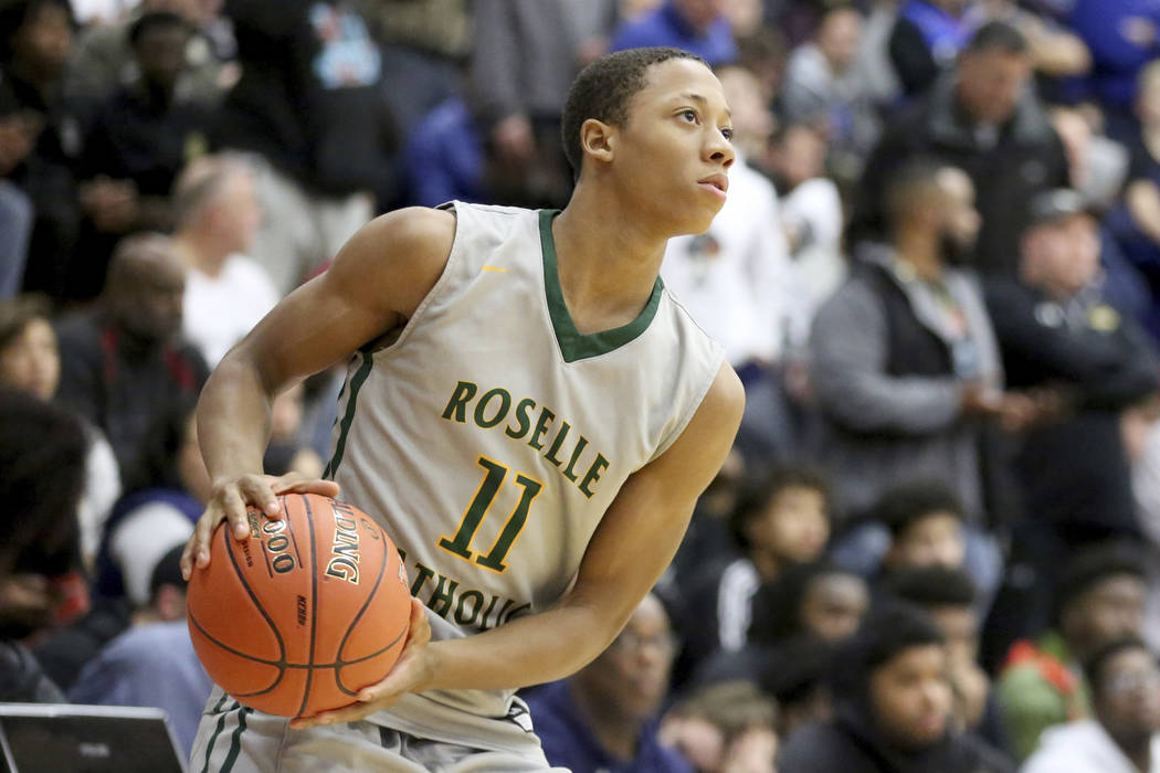 Roselle Catholic's Josh Pierre Louis #11 in action against Oak Ridge during a high school basketball game at the Hoophall Classic, Saturday, January 13, 2018, in Springfield, MA. Oak Ridge won the ...