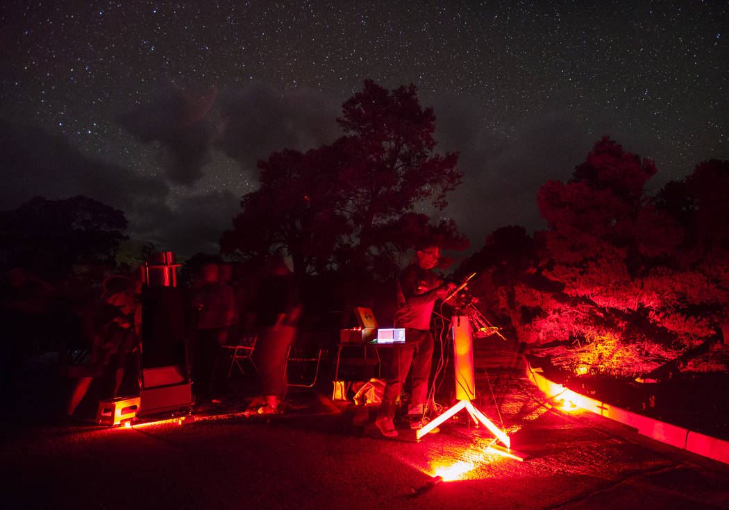 Jeff Kaufman of Chapel Hill, N.C., looks for sets up his camera with a star tracker to photograph the andromeda galaxy during the final day of the annual astronomy festival at Great Basin National ...