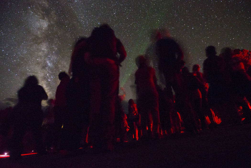 National Park Service Ranger Annie Gilliland uses a green laser pointer to highlight constellations and other points of interest in the night sky during the final day of the annual astronomy festi ...