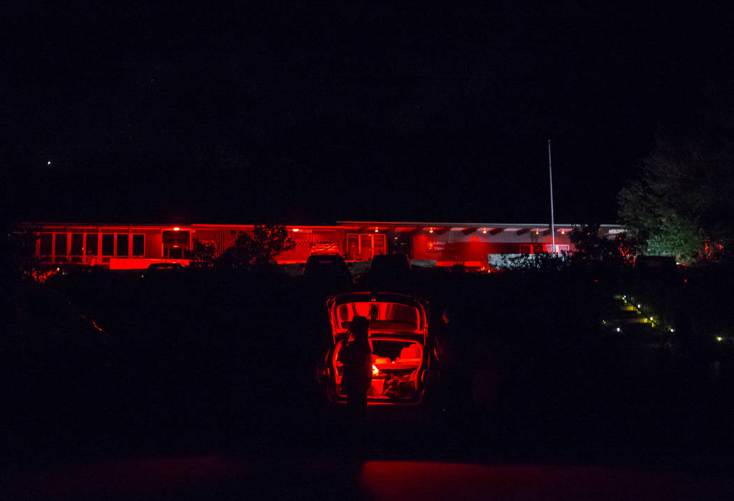 Red lights, used by astronomers to minimize the visual impact to the eye while stargazing, light up the Lehman Caves Visitor Center as people attend the final day of the annual astronomy festival ...