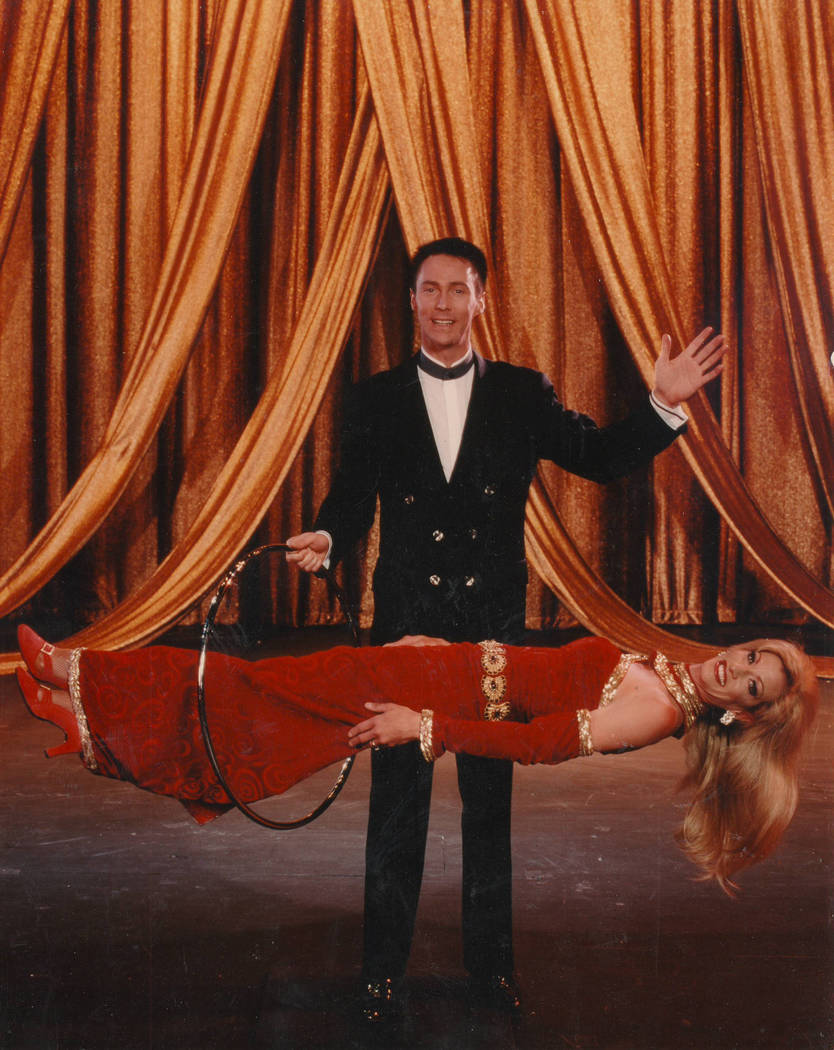 """For more than a decade, she also worked as one of magician Lance Burton """"babes"""" at the Monte Carlo. She's shown here in 2008 during Burton's levitation act. (Courtesy of Lance Burton)"""
