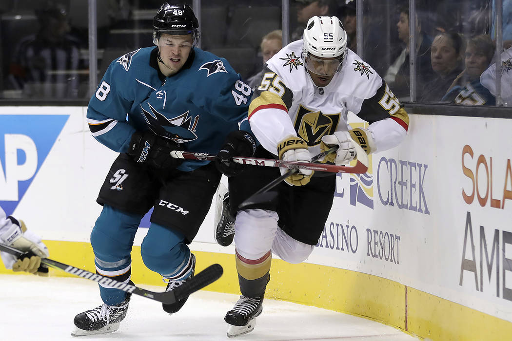 San Jose Sharks center Tomas Hertl (48) and Vegas Golden Knights right wing Keegan Kolesar (55) chase the puck during the first period of a preseason NHL hockey game, Thursday, Sept. 21, 2017, in ...