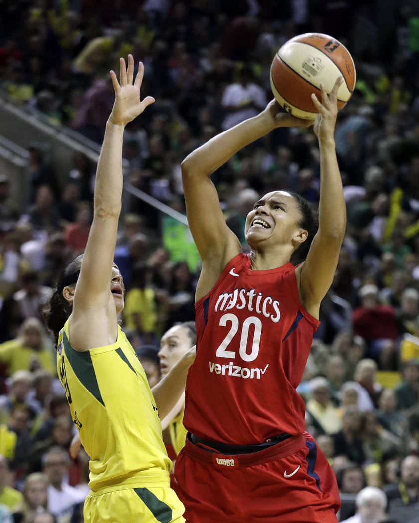 Washington Mystics' Kristi Toliver (20) shoots over Seattle Storm's Sue Bird in the first half of Game 2 of the WNBA basketball finals Sunday, Sept. 9, 2018, in Seattle. (AP Photo/Elaine Thompson)