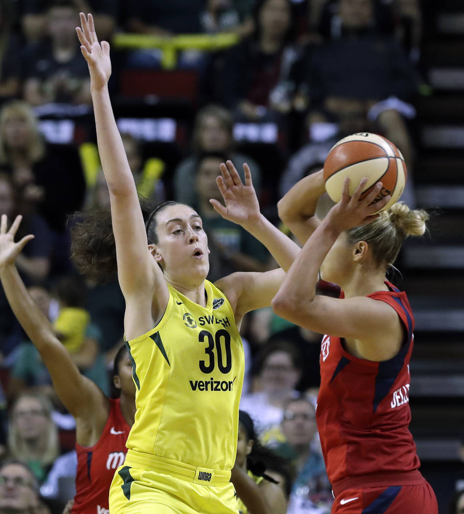 Seattle Storm's Breanna Stewart (30) defends Washington Mystics' Elena Delle Donne in the first half of Game 2 of the WNBA basketball finals Sunday, Sept. 9, 2018, in Seattle. (AP Photo/Elaine Tho ...