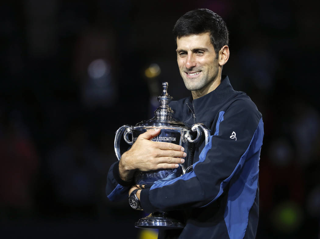 Novak Djokovic, of Serbia, holds the trophy after defeating Juan Martin del Potro, of Argentina, during the men's final of the U.S. Open tennis tournament, Sunday, Sept. 9, 2018, in New York. (AP ...