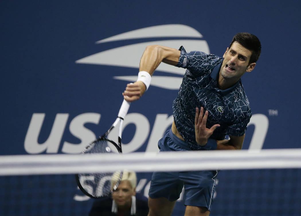 Novak Djokovic, of Serbia, serves to Juan Martin del Potro, of Argentina, during the men's final of the U.S. Open tennis tournament, Sunday, Sept. 9, 2018, in New York. (AP Photo/Andres Kudacki)