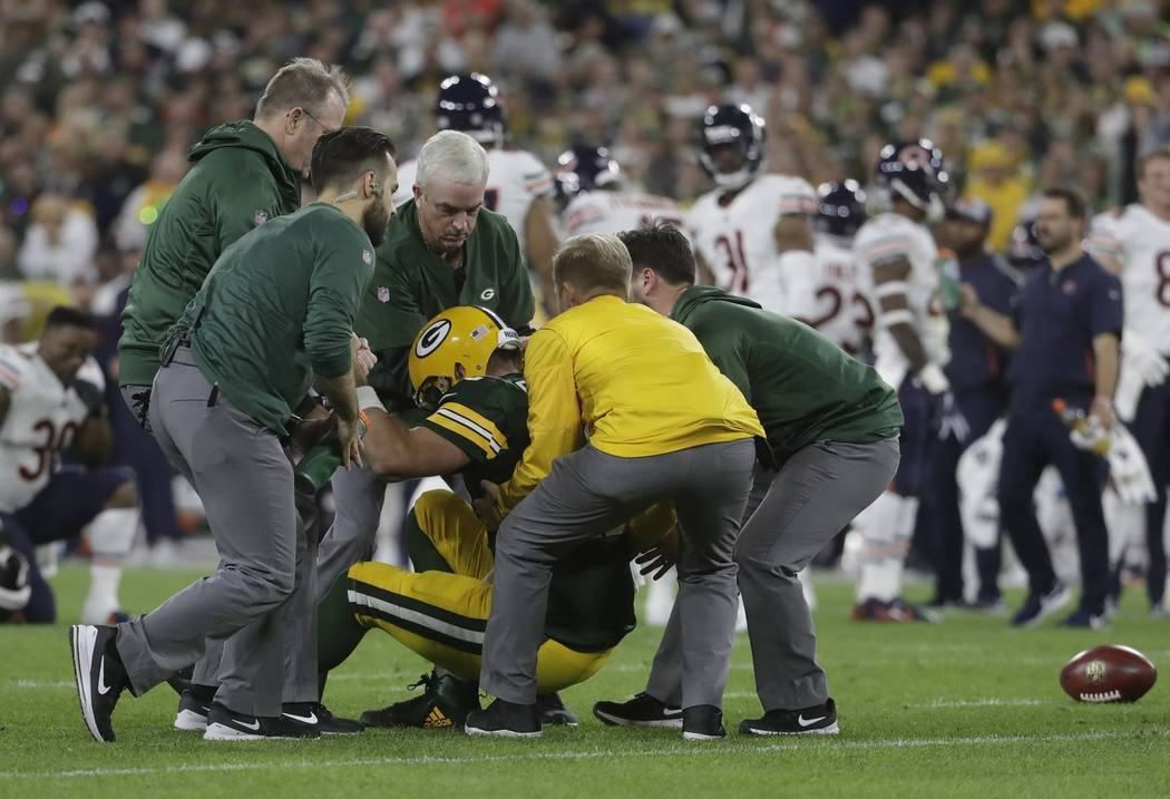 Green Bay Packers quarterback Aaron Rodgers is hurt after being sacked during the first half of an NFL football game against the Chicago Bears Sunday, Sept. 9, 2018, in Green Bay, Wis. (AP Photo/M ...