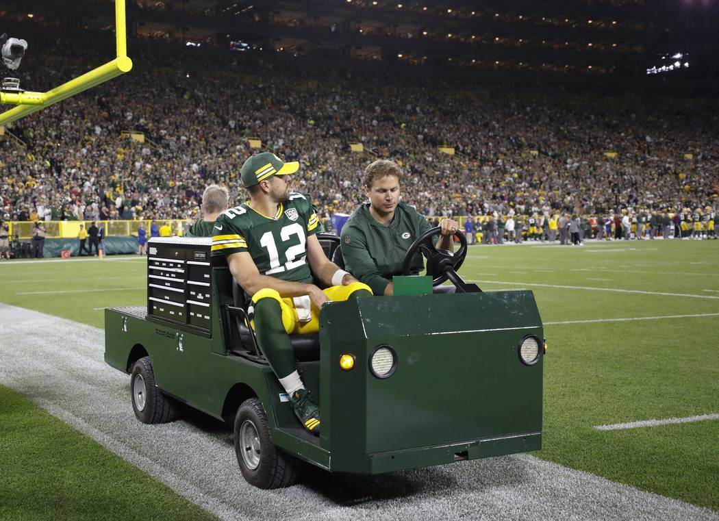Green Bay Packers' Aaron Rodgers is taken off the field on a cart after injuring his leg during the first half of an NFL football game against the Chicago Bears Sunday, Sept. 9, 2018, in Green Bay ...
