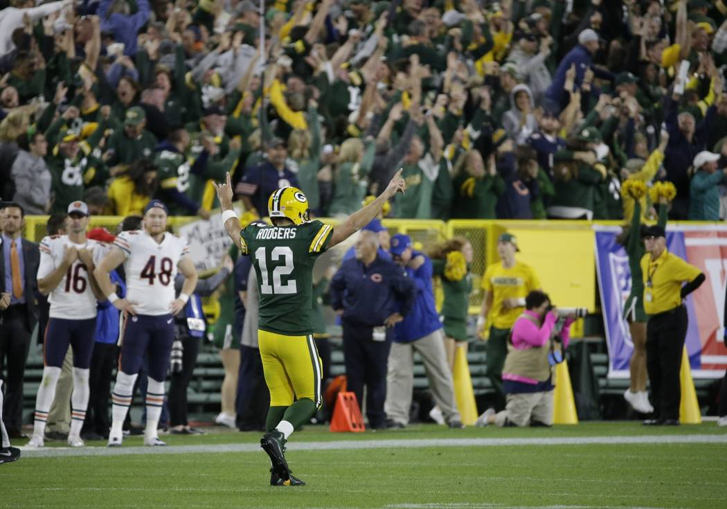 Green Bay Packers' Aaron Rodgers reacts after throwing a 75-yard touchdown pass to Randall Cobb during the second half of an NFL football game against the Chicago Bears Sunday, Sept. 9, 2018, in G ...