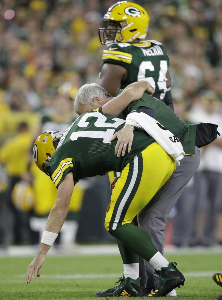 Green Bay Packers quarterback Aaron Rodgers is hurt after being sacked during the first half of an NFL football game against the Chicago Bears Sunday, Sept. 9, 2018, in Green Bay, Wis. (AP Photo/J ...