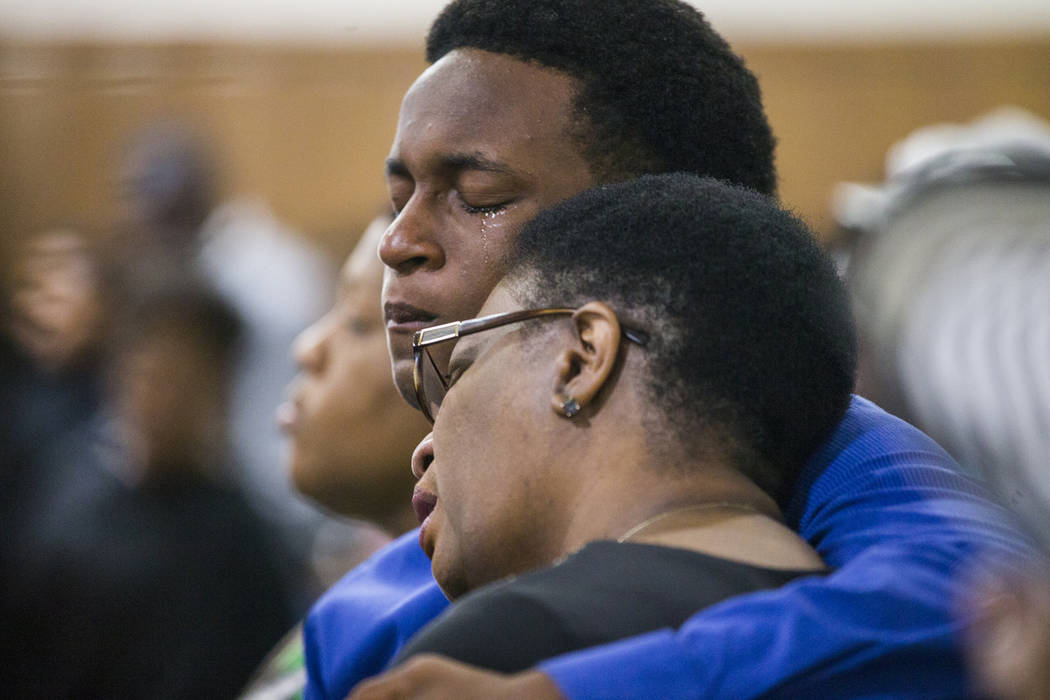 Allison Jean and her son Grant, 15, mourn Botham Jean, Allison's son and Grant's brother during a prayer service for Jean at the Dallas West Church of Christ on Sunday, Sept. 9, 2018 in Dallas. B ...