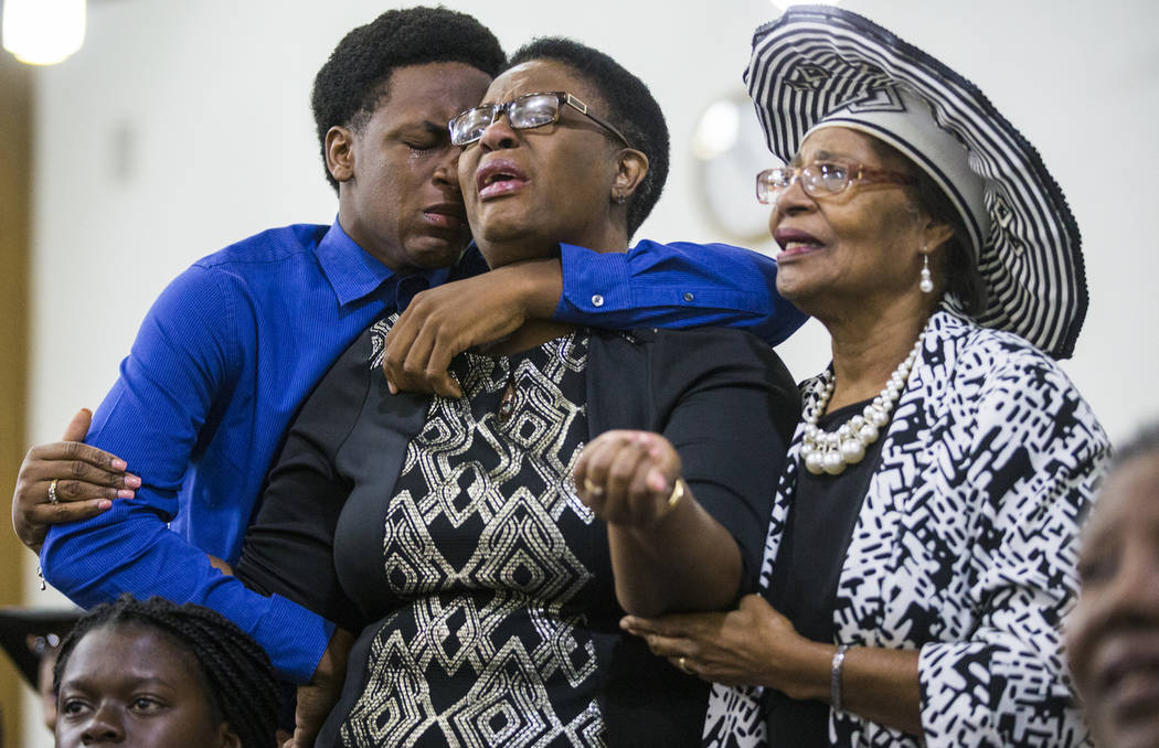 Grant Jean, 15, and his mother Allison Jean, who are the brother and mother of Botham Jean mourn with another churchgoer during a prayer service for Jean at the Dallas West Church of Christ on Sun ...