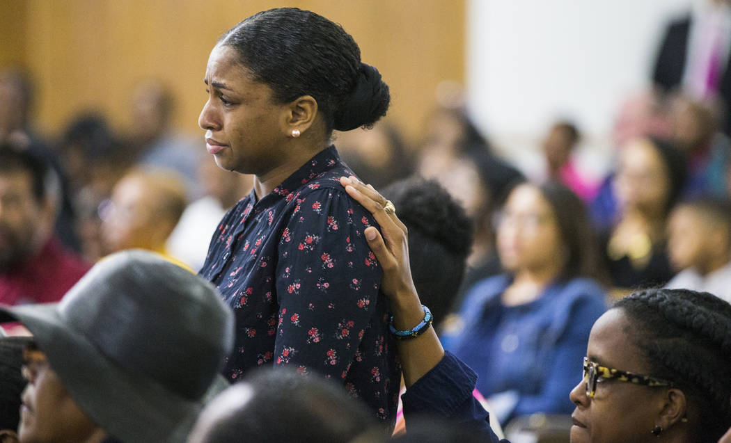 Cynthia Johnson, Botham Jean's girlfriend, stands up as she is comforted by another churchgoer during a prayer service for Jean at the Dallas West Church of Christ on Sunday, Sept. 9, 2018 in Dall ...