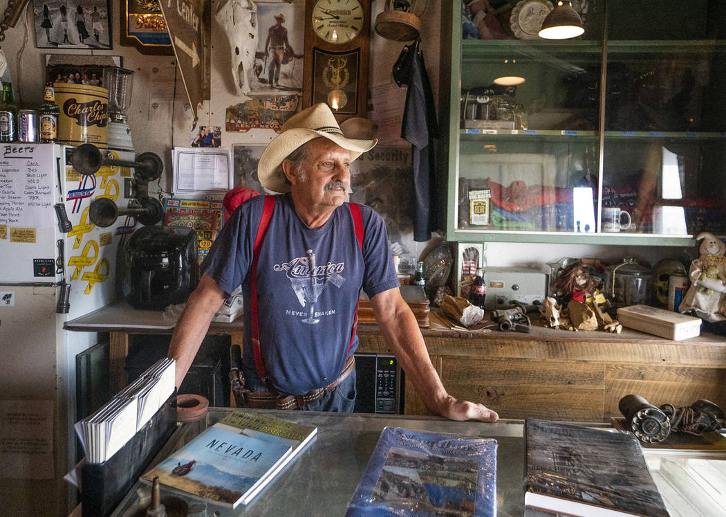 In this Tuesday, Sept. 4, 2018 photo, Walt Kremin poses for a photograph in his saloon at Gold Point, Nev. The 10 residents of the rural western Nevada ghost town of Gold Point will finally have a ...