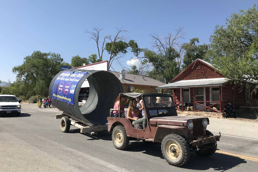 A parade entry protesting the Southern Nevada Water Authority's proposed pipeline from rural Nevada rolls down the street in Baker during the annual Snake Valley Festival on Sept. 1. (Henry Brean/ ...