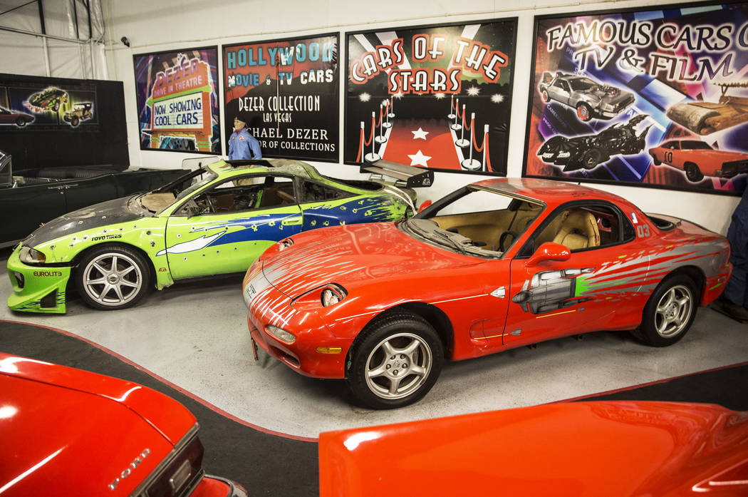 The 1996 Mitsubishi Eclipse, left, and the 1993 Mazda RX-7 featured in the first of the Fast and the Furious movie series at the Hollywood Cars Museum on Tuesday, April, 4, 2017, at Hot Rod City, ...