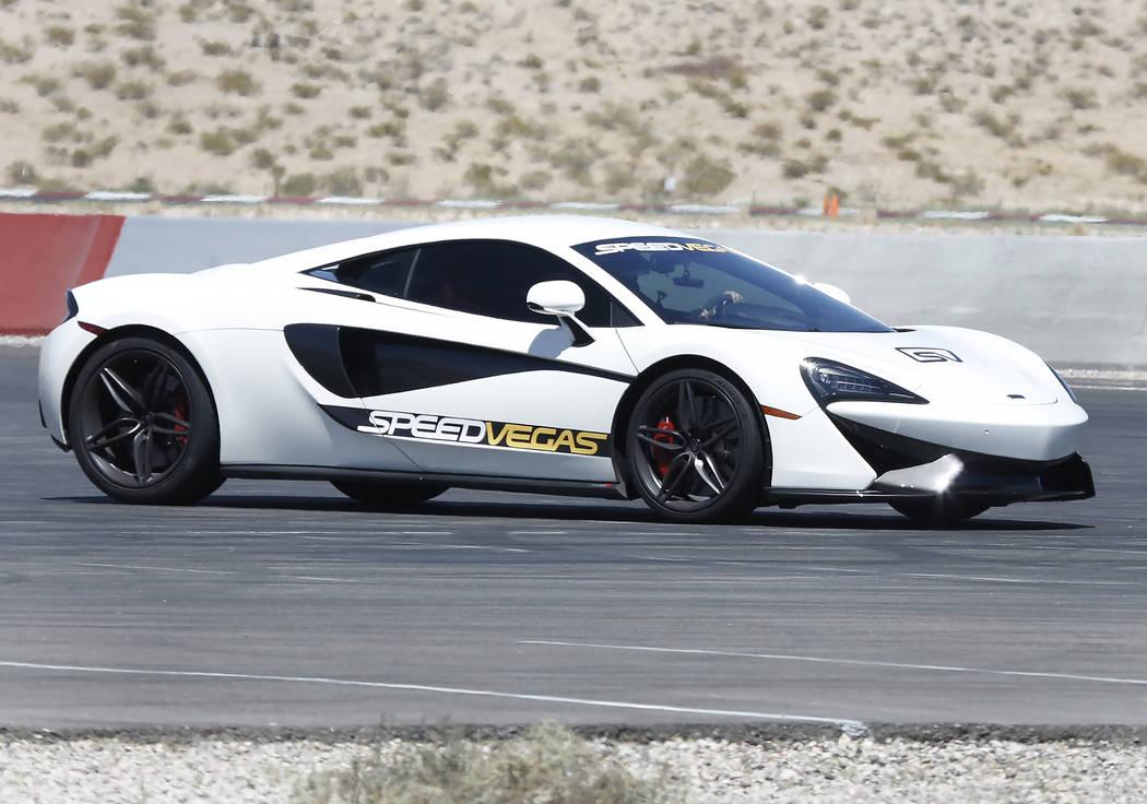 A customer drives an exotic car at SpeedVegas in Henderson on Thursday, June 29, 2017. Bizuayehu Tesfaye/Las Vegas Review-Journal @bizutesfaye