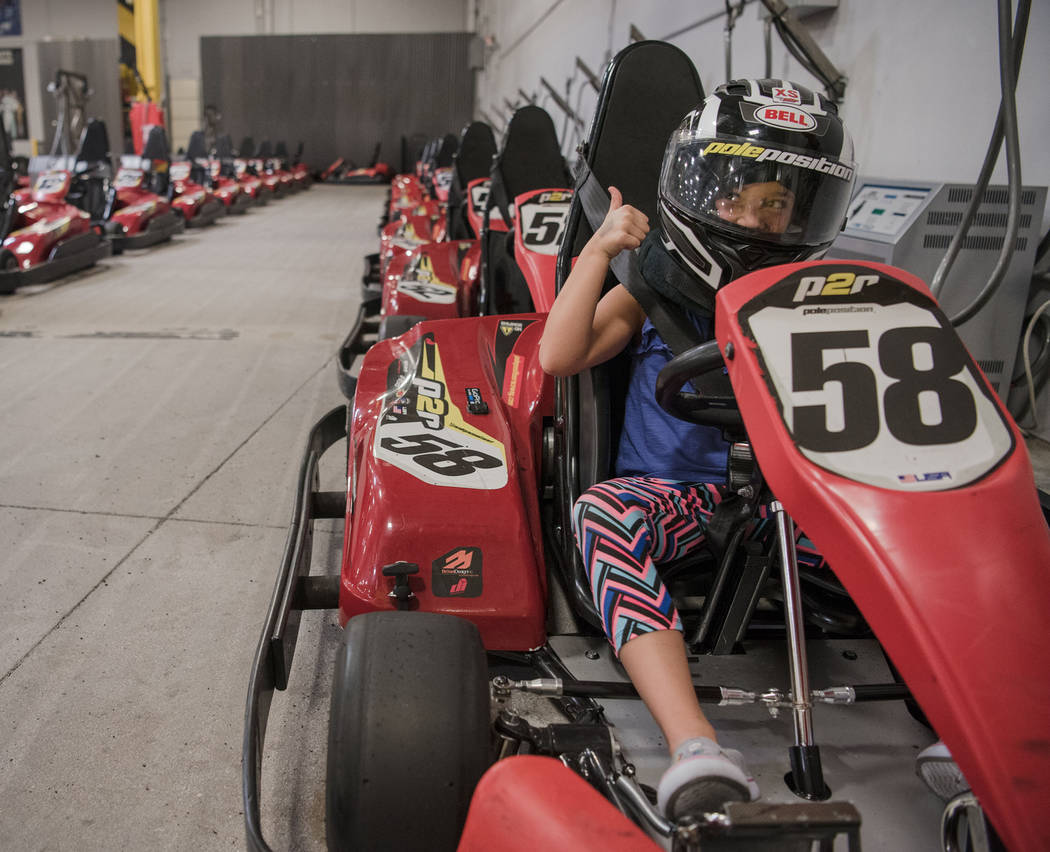 Zoe Kenner, 7, gives her dad a thumbs up before their kart race at Pole Position Raceway on Saturday, July 22, 2017, in Las Vegas. Morgan Lieberman Las Vegas Review-Journal