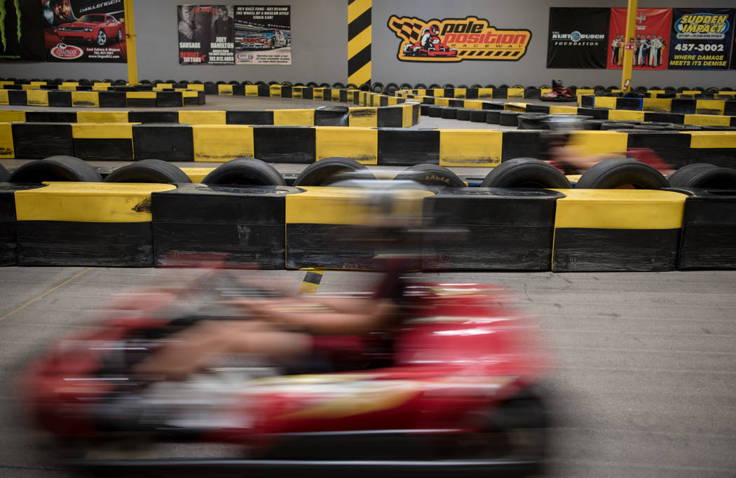 Kart racers accelerate around the track at Pole Position Raceway on Saturday, July 22, 2017, in Las Vegas. Morgan Lieberman Las Vegas Review-Journal