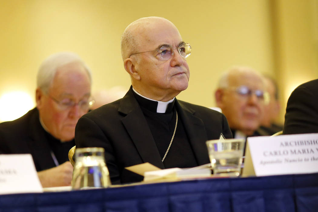 Archbishop Carlo Maria Vigano, Apostolic Nuncio to the U.S., listens to remarks at the U.S. Conference of Catholic Bishops' annual fall meeting in Baltimore, Nov. 16, 2015. Vigano accused Pope Fra ...