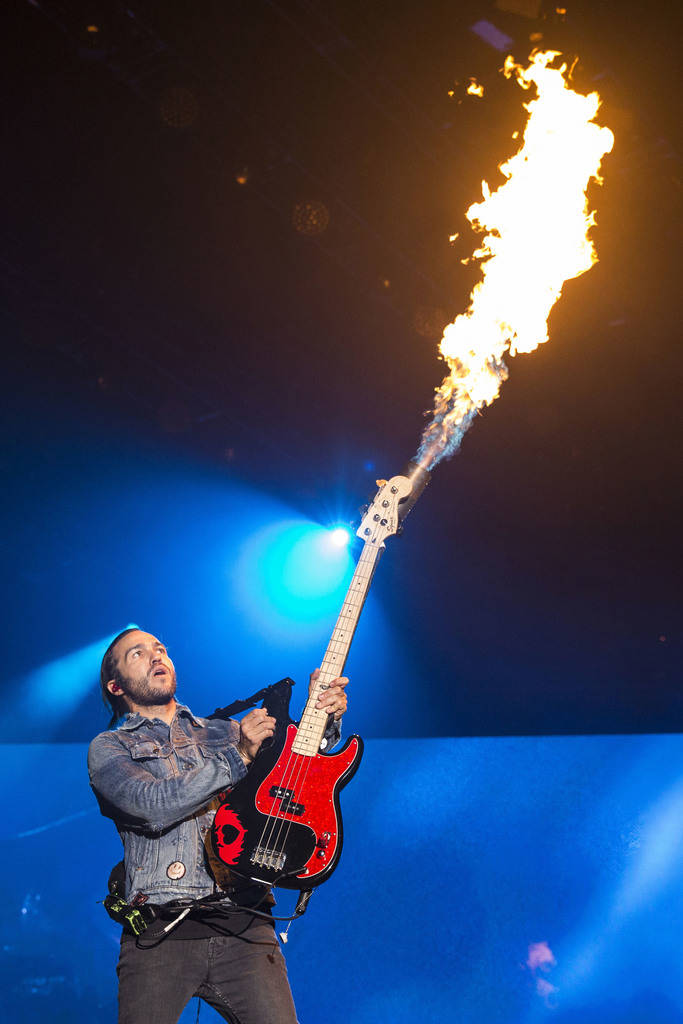 Pete Wentz, of Fall Out Boy, performs at Wrigley Field, Saturday, Sept. 8, 2018. (Ashlee Rezin/Chicago Sun-Times via AP)