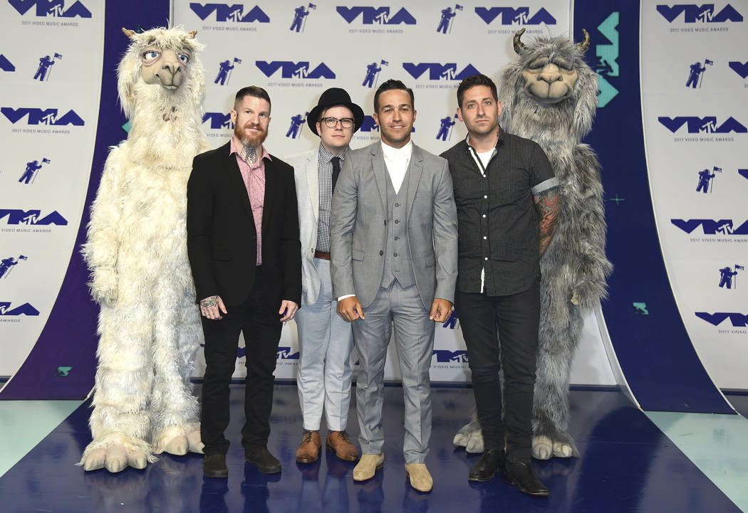 Andy Hurley, from left, Patrick Stump, Pete Wentz, and Joe Trohman of Fall Out Boy arrive at the MTV Video Music Awards at The Forum on Sunday, Aug. 27, 2017, in Inglewood, Calif. (Photo by Jordan ...