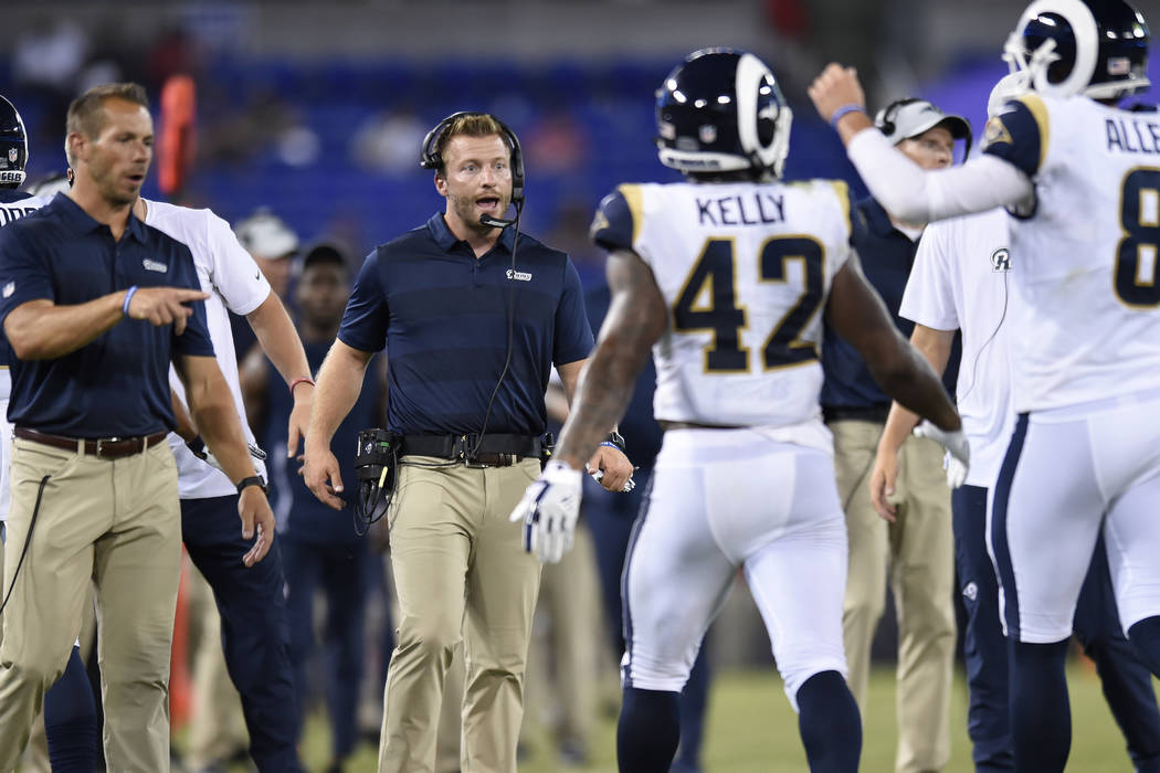 Los Angeles Rams head coach Sean McVay, center, stands on the sideline in the second half of a preseason NFL football game against the Baltimore Ravens, Thursday, Aug. 9, 2018, in Baltimore. (Gail ...
