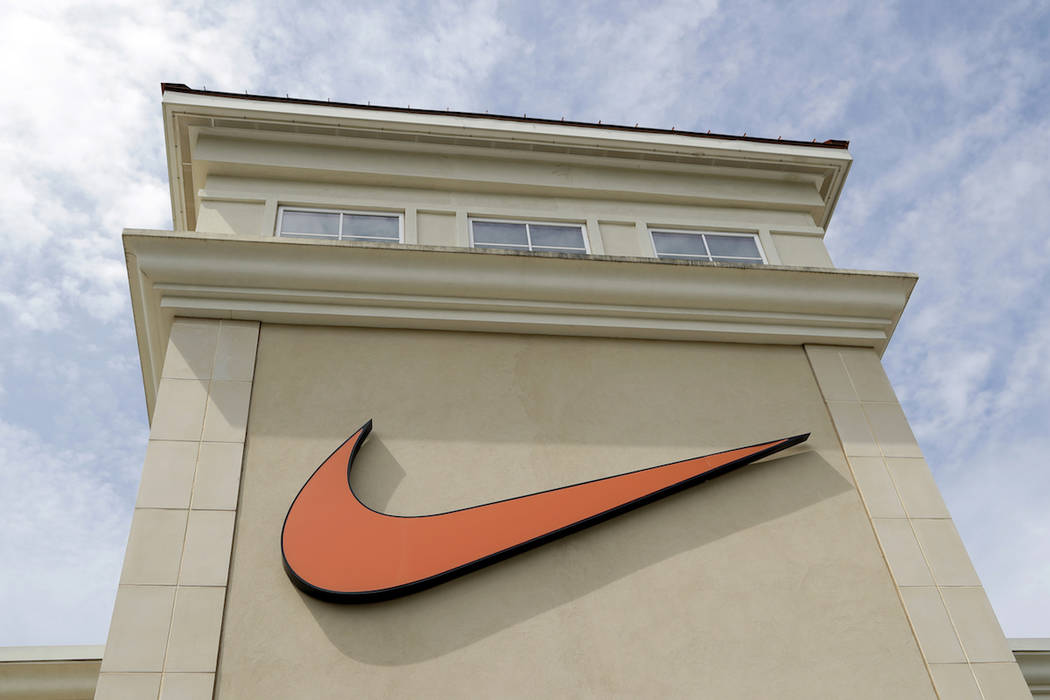 A Nike logo is shown outside a Nike store in Charlotte, N.C., Tuesday, Sept. 4, 2018. (AP Photo/Chuck Burton)