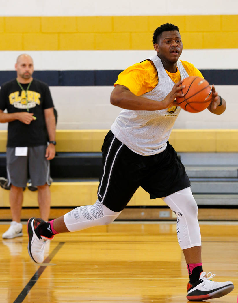 Clark forward-center Antwon Jackson looks to pass during a practice at Clark High School in Las Vegas, Tuesday, Sept. 11, 2018, as head coach Chad Beaten, background, looks on. Chitose Suzuki Las ...