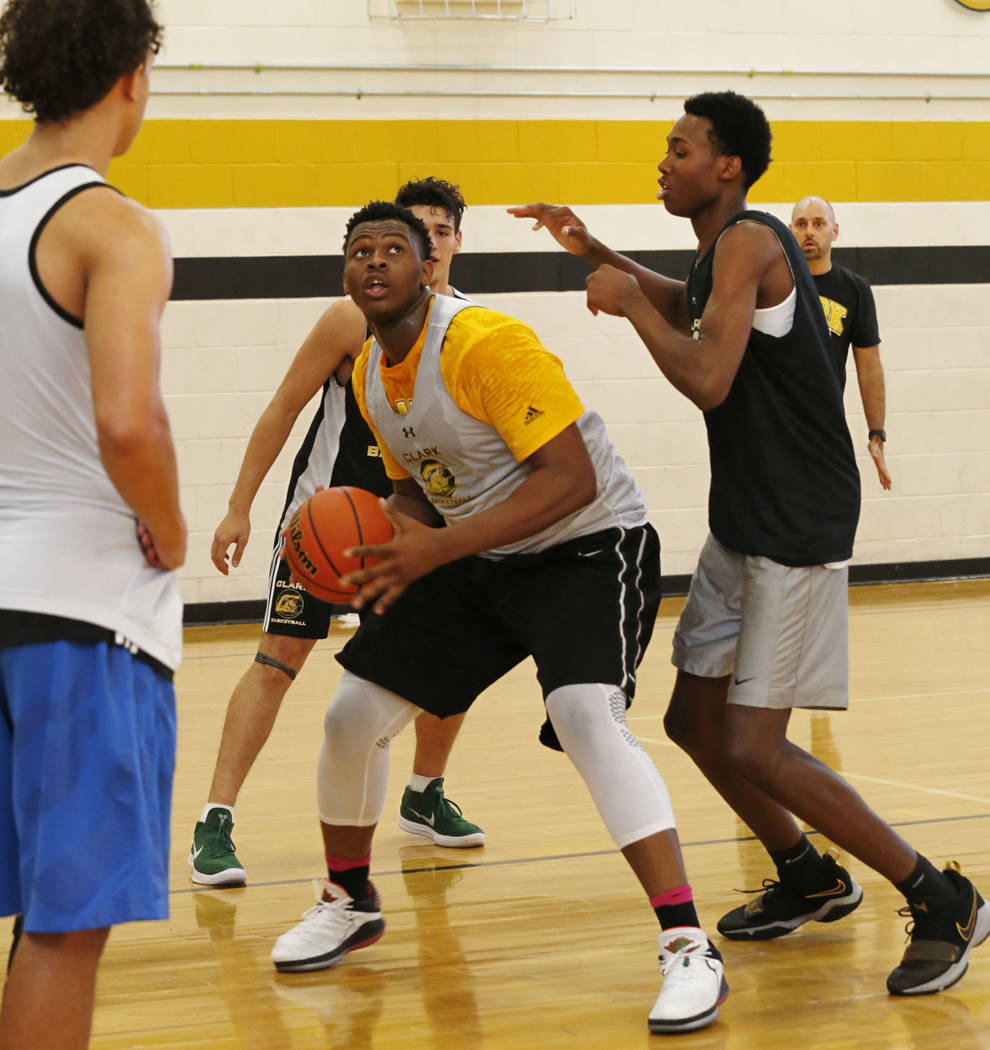 Clark forward-center Antwon Jackson, center, keeps a ball away from his teammate Iverson Smith, right, during a practice at Clark High School in Las Vegas, Tuesday, Sept. 11, 2018. Chitose Suzuki ...