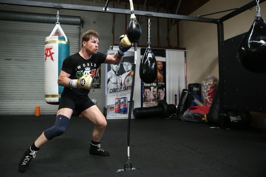"Boxer Saul ""Canelo"" Alvarez, right, works out at his gym in San Diego, Calif., Friday, July 27, 2018. Erik Verduzco Las Vegas Review-Journal @Erik_Verduzco"