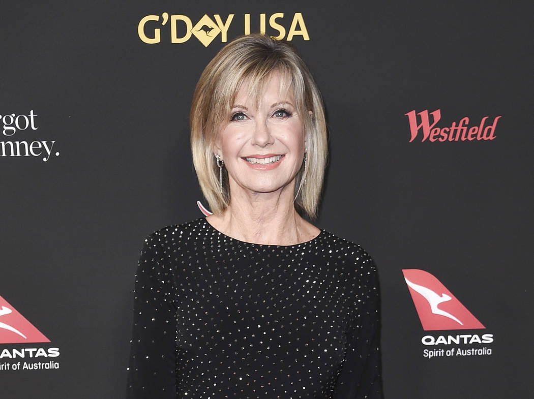 FILe - In this Jan. 27, 2018 file photo, Olivia Newton-John attends the 2018 G'Day USA Los Angeles Gala at the InterContinental Hotel Los Angeles. Newton-John says she has been diagnosed with canc ...