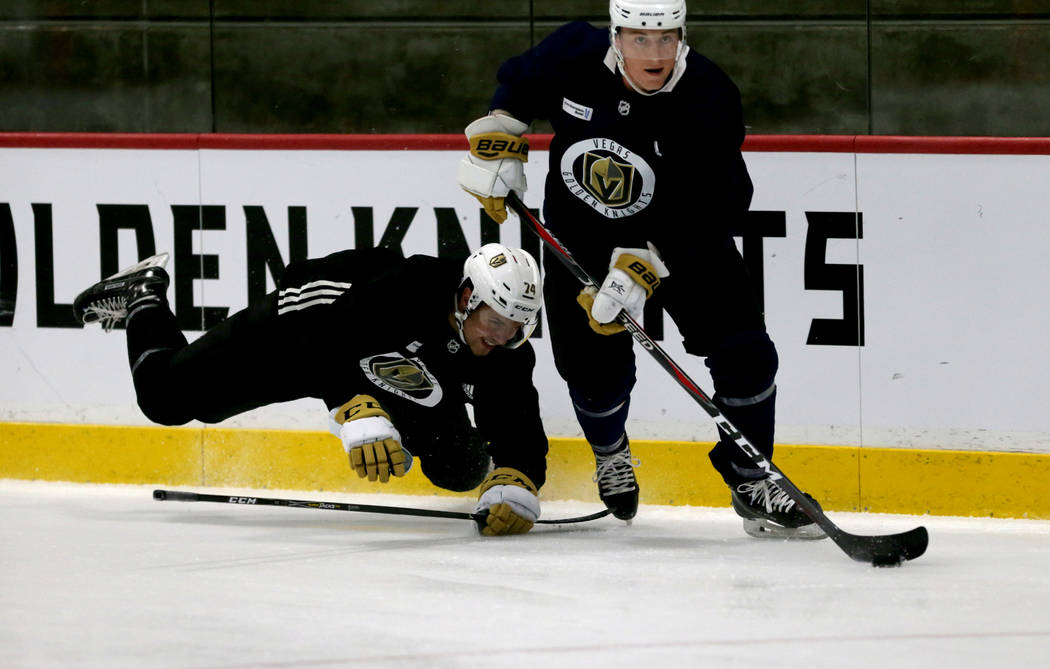 Vegas Golden Knights forward Ben Jones (61) handles the puck in front of defenseman Martin Bodak (74) during practice at City National Arena Monday, Sept. 10, 2018. K.M. Cannon Las Vegas Review-Jo ...