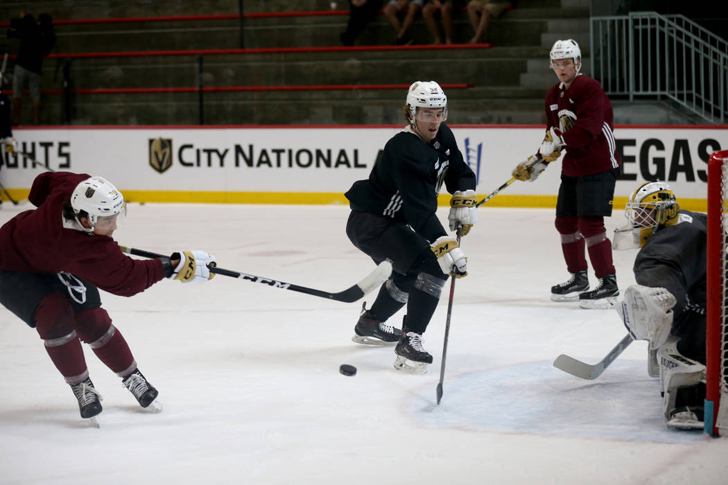 Vegas Golden Knights Tyler Wong (80) shoots past defenseman Dylan Coghlan (52) during practice at City National Arena Monday, Sept. 10, 2018. K.M. Cannon Las Vegas Review-Journal @KMCannonPhoto