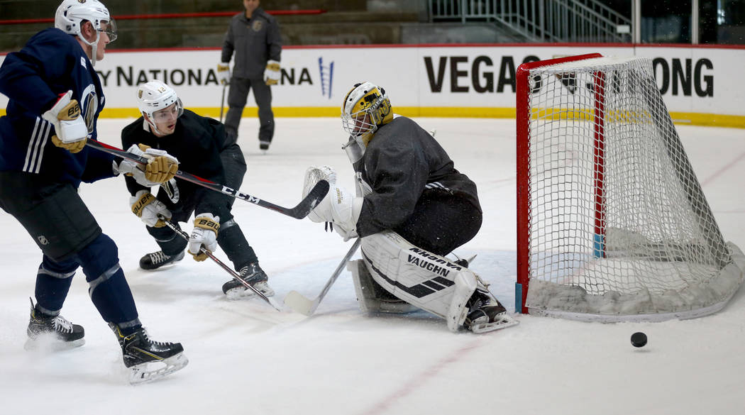 Vegas Golden Knights, from left, Dylan Coghlan (52), Erik Brannstrom (12) and goaltender Jiri Patera (32) during practice at City National Arena Monday, Sept. 10, 2018. K.M. Cannon Las Vegas Revie ...