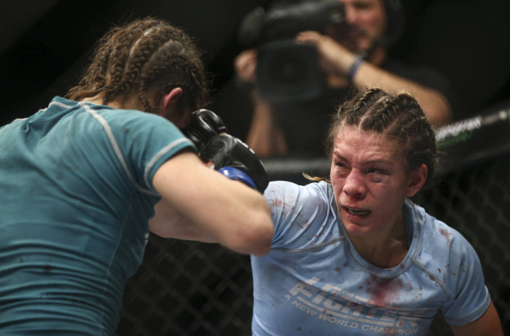 Nicco Montano, right, fights Roxanne Modafferi during a women's flyweight title bout at the Park Theater at Monte Carlo in Las Vegas on Friday, Dec. 1, 2017. Montano won via unanimous decision. C ...