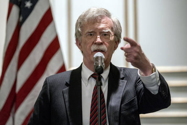 National security adviser John Bolton calls on a reporter during a news conference after speaking at a Federalist Society luncheon at the Mayflower Hotel, Monday, Sept. 10, 2018, in Washington. (A ...