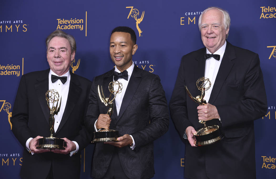 "Andrew Lloyd Webber, left, John Legend, and Tim Rice winners of the award for outstanding variety special for ""Jesus Christ Superstar Live in Concert"" poses in the press room during nigh ..."