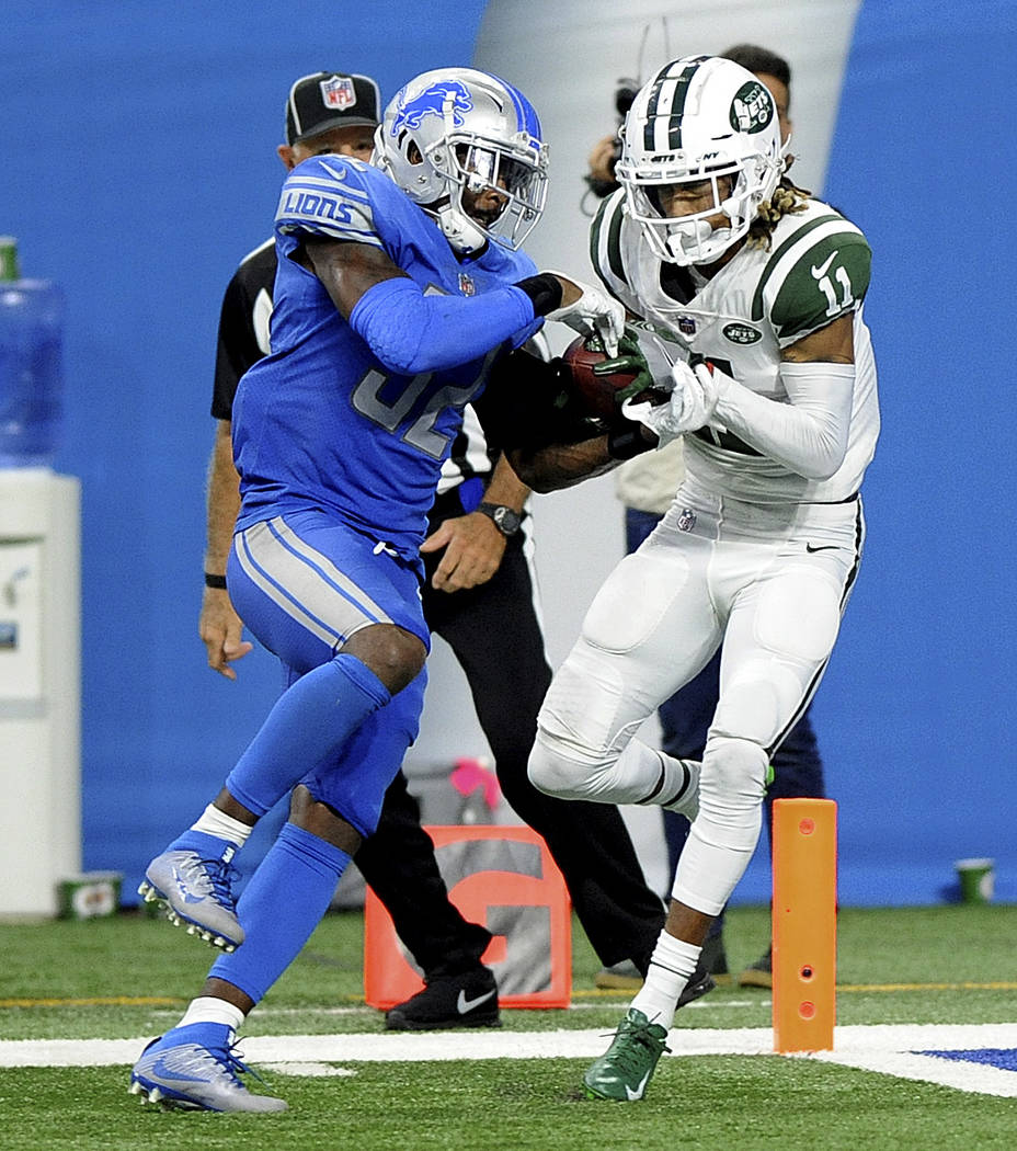 New York Jets wide receiver Robby Anderson (11) pulls down a 41-yard touchdown reception as Detroit Lions defensive back Tavon Wilson (32) defends during an NFL football game in Detroit, Monday, S ...