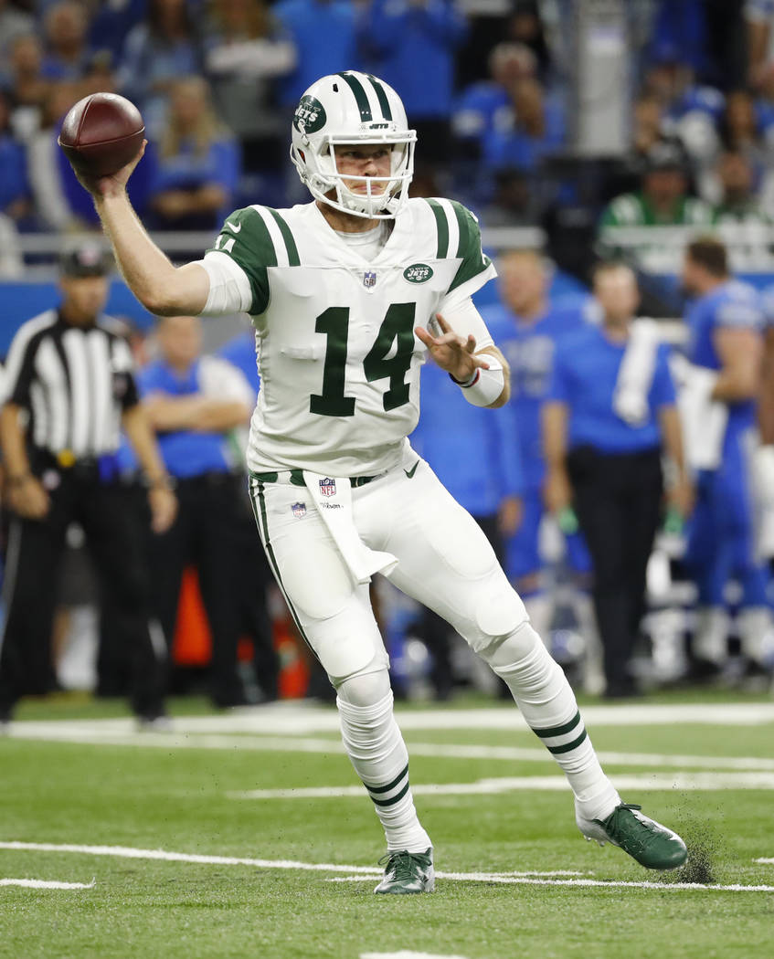 New York Jets quarterback Sam Darnold (14) throws against the Detroit Lions in the first half of an NFL football game in Detroit, Monday, Sept. 10, 2018. (AP Photo/Rick Osentoski)
