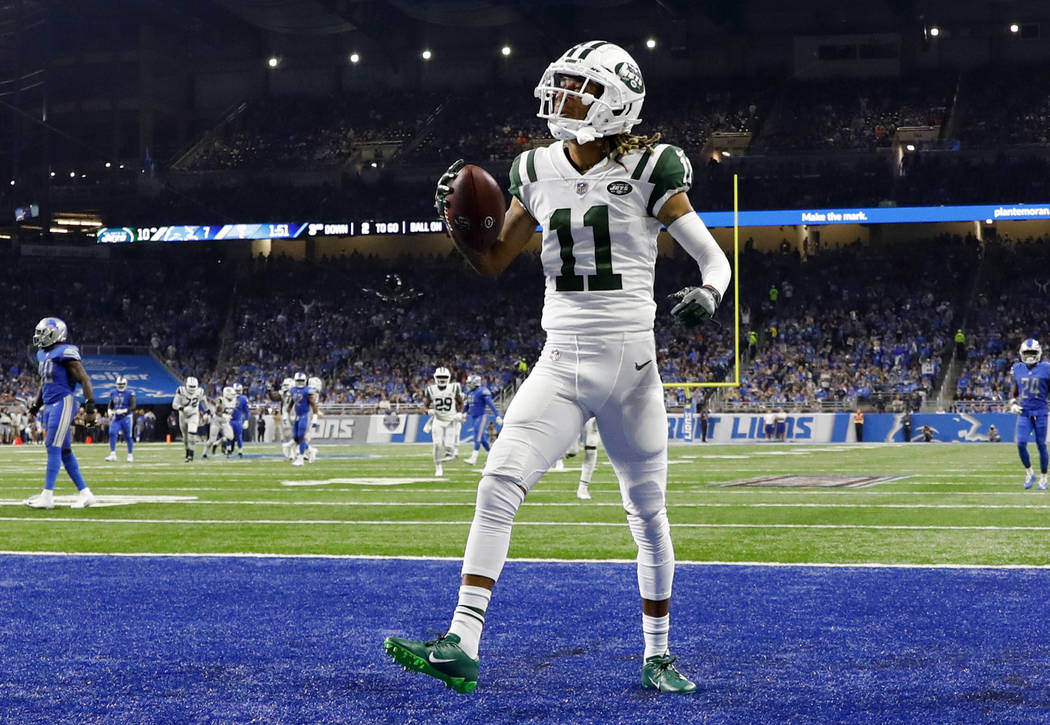 New York Jets wide receiver Robby Anderson (11) celebrates his 41-yard touchdown reception against the Detroit Lions during the first half of an NFL football game in Detroit, Monday, Sept. 10, 201 ...