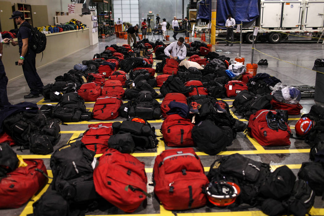 Eric Henderson of Nevada Task Force 1, top right, packs his bags before deployment to Georgia in the wake of Hurricane Irma at their headquarters in Las Vegas, Thursday, Sept. 7, 2017. Joel Angel ...