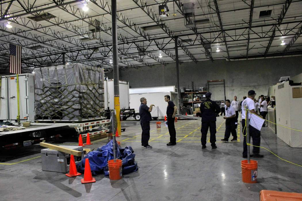 Members of Nevada Task Force One make their final preparations on Sept. 11, 2018, before deploying to Virginia, where the team will support local agencies responding to Hurricane Florence. (Max Mi ...
