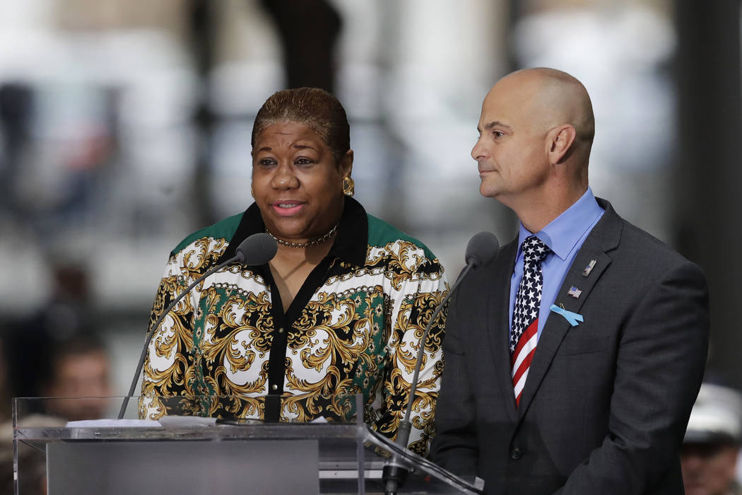La-Shawn Clark, left, and Mark Cannizzaro read names of victims of the Sept. 11 attacks during a ceremony marking the 17th anniversary on Tuesday, Sept. 11, 2018, in New York. Clark lost her husba ...