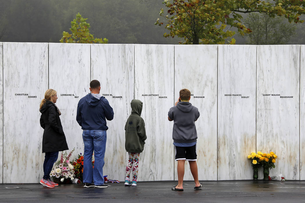 Visitors to the Flight 93 National Memorial in Shanksville, Pennsylvania, participate in a sunset memorial service on Monday, Sept. 10, 2018, as the nation marks the 17th anniversary of the Sept. ...