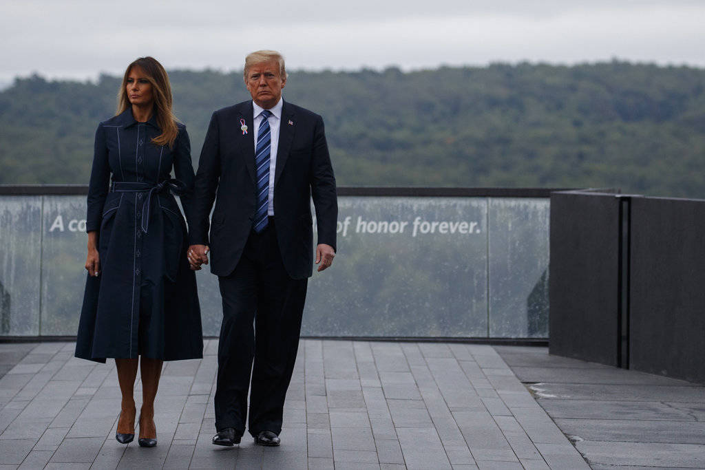 President Donald Trump and first lady Melania Trump walk along the September 11th Flight 93 memorial, Tuesday, Sept. 11, 2018, in Shanksville, Pa. (AP Photo/Evan Vucci)