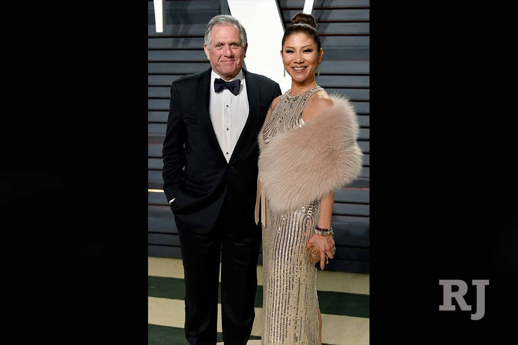 In this Feb. 26, 2017 file photo, Les Moonves, left, and Julie Chen arrive at the Vanity Fair Oscar Party in Beverly Hills, Calif. (Evan Agostini/Invision/AP file)