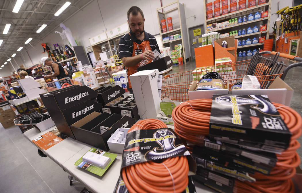 James Wemyss puts out more supplies at The Home Depot on Monday, Sept. 10, 2018, in Wilmington, N.C. Florence rapidly strengthened into a potentially catastrophic hurricane on Monday as it closed ...